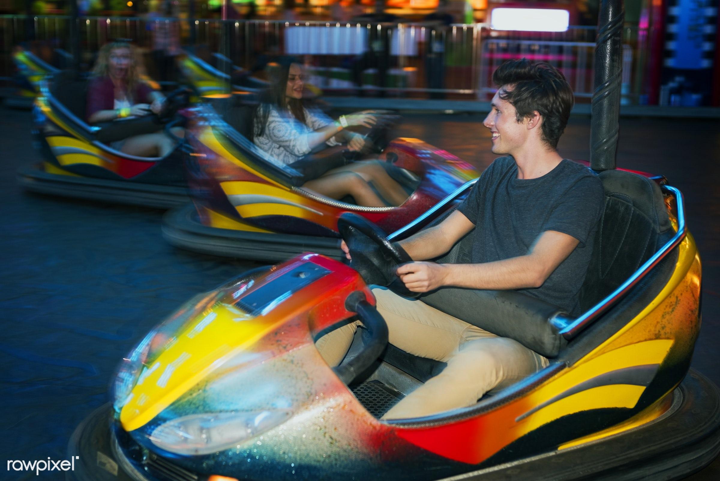 A group of friends is enjoying the amusement park - amusement park, bumper, car, enjoyment, expression, feeling, friends,...