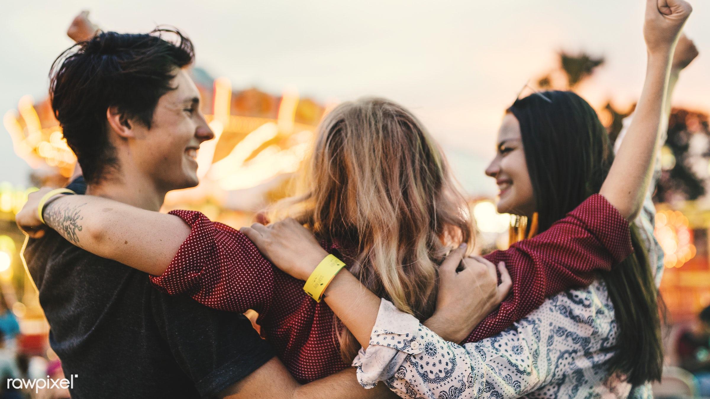 A group of friends is enjoying the amusement park - amusement park, enjoyment, expression, feeling, friends, friendship, fun...