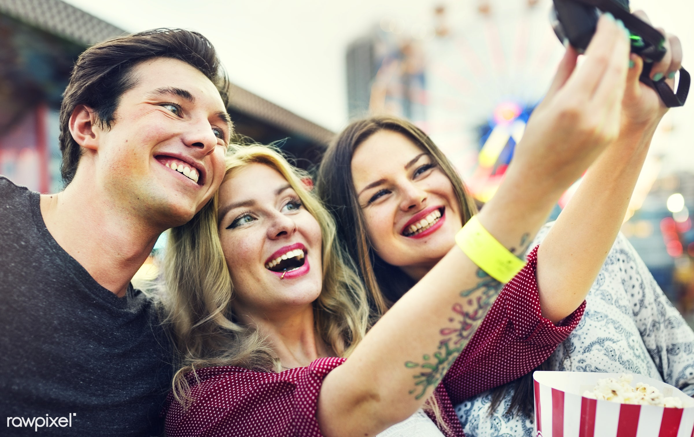 A group of friends is enjoying the amusement park - selfie, amusement park, camera, device, digital, eat, enjoyment,...