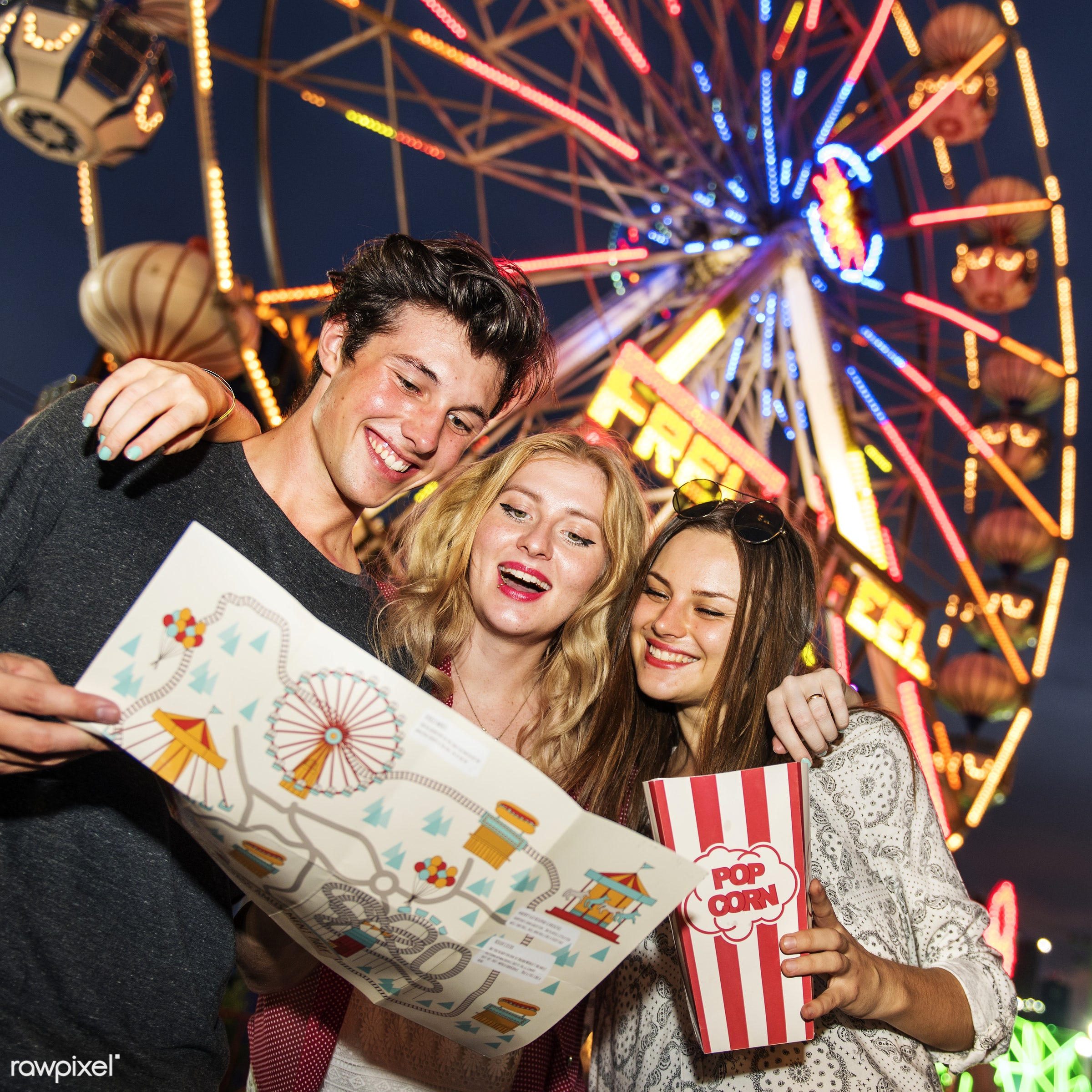 A group of friends is enjoying the amusement park - amusement park, direction, enjoyment, expression, feeling, ferris wheel...