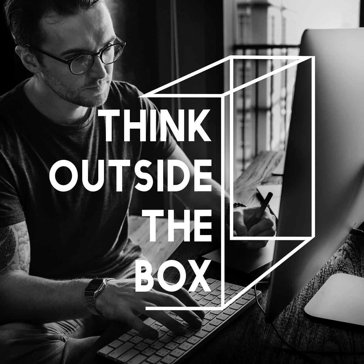 Think outside the box phrase on man working on computer background