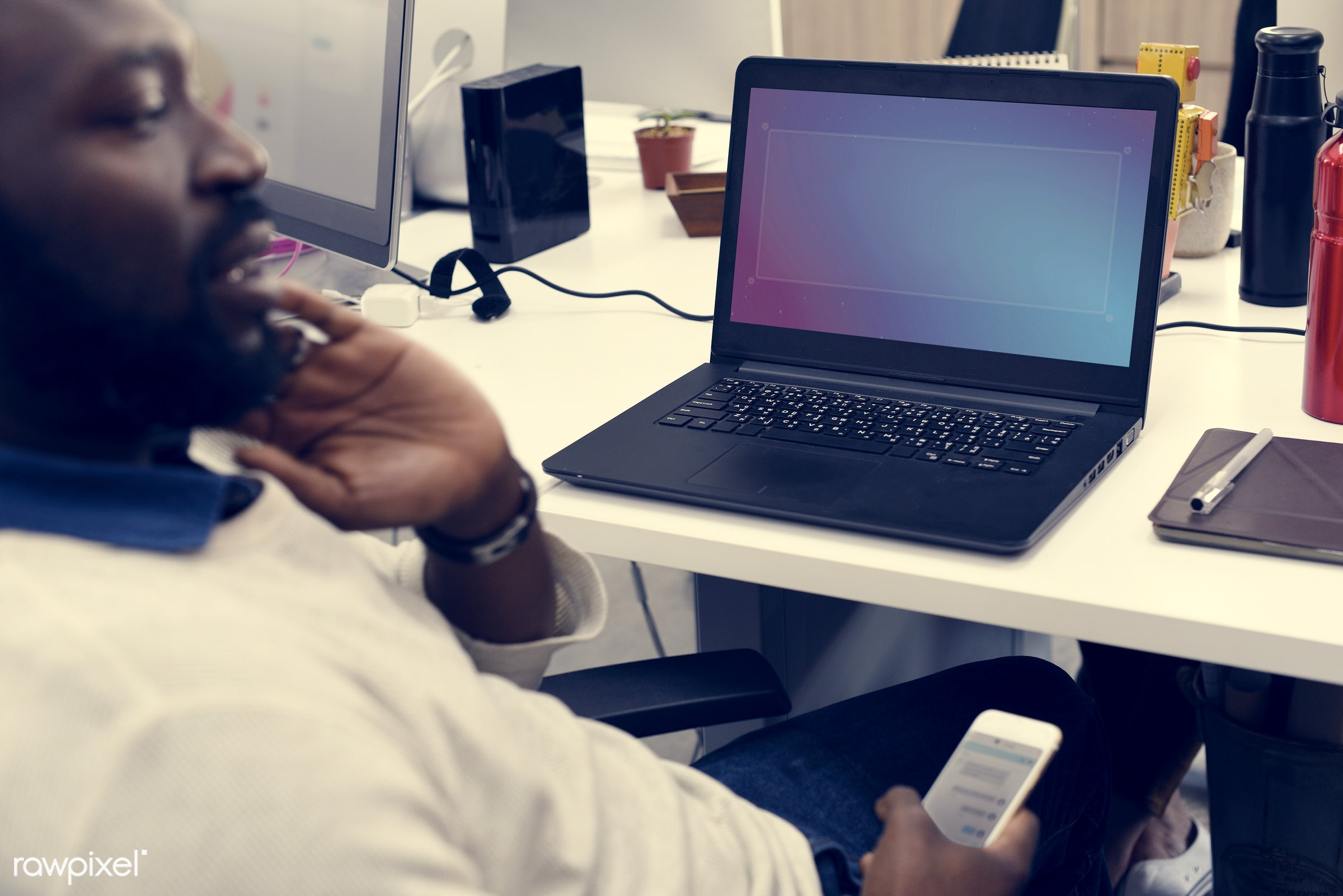 Man at workplace - african american, african descent, alone, black, break, cellphone, device, digital, digital device,...