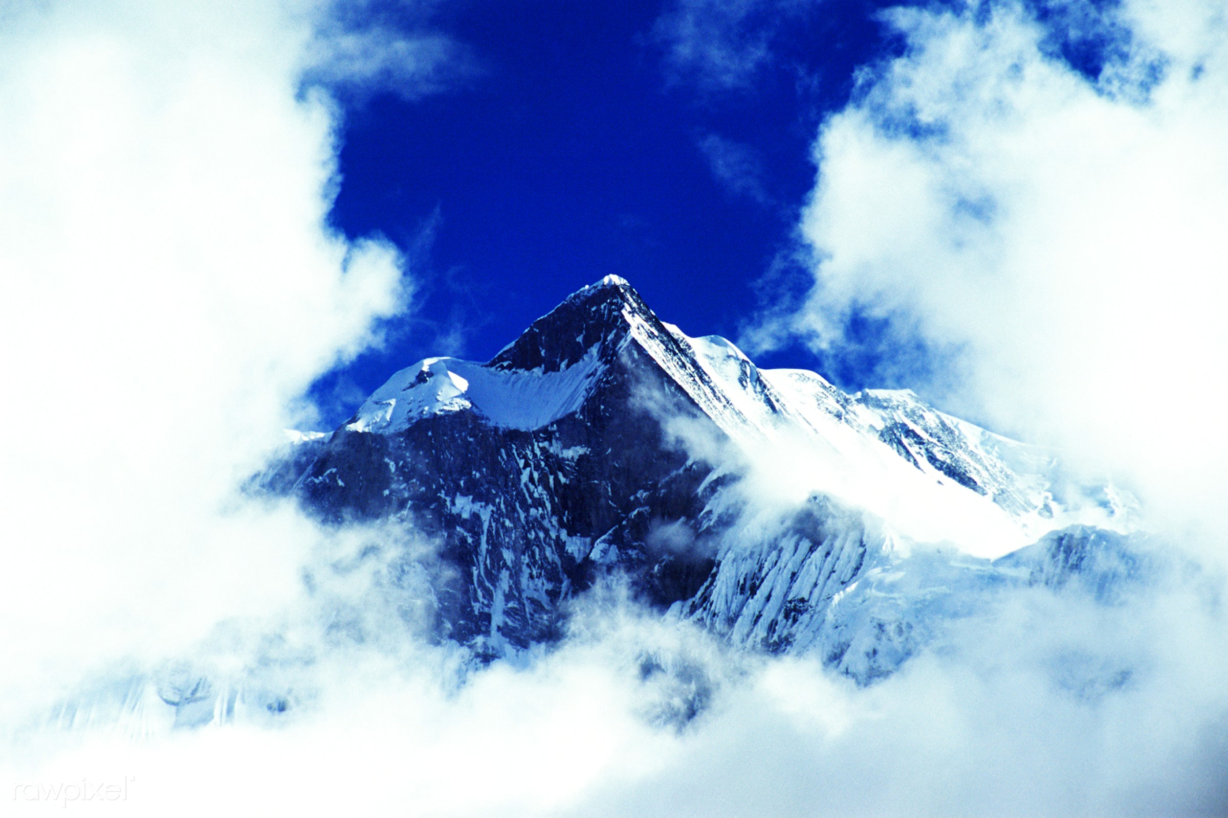 Above the clouds of a mountain peak in the Himalayas - above, adventure, aspirations, awe, blue, bright, cloud, cloudscape,...