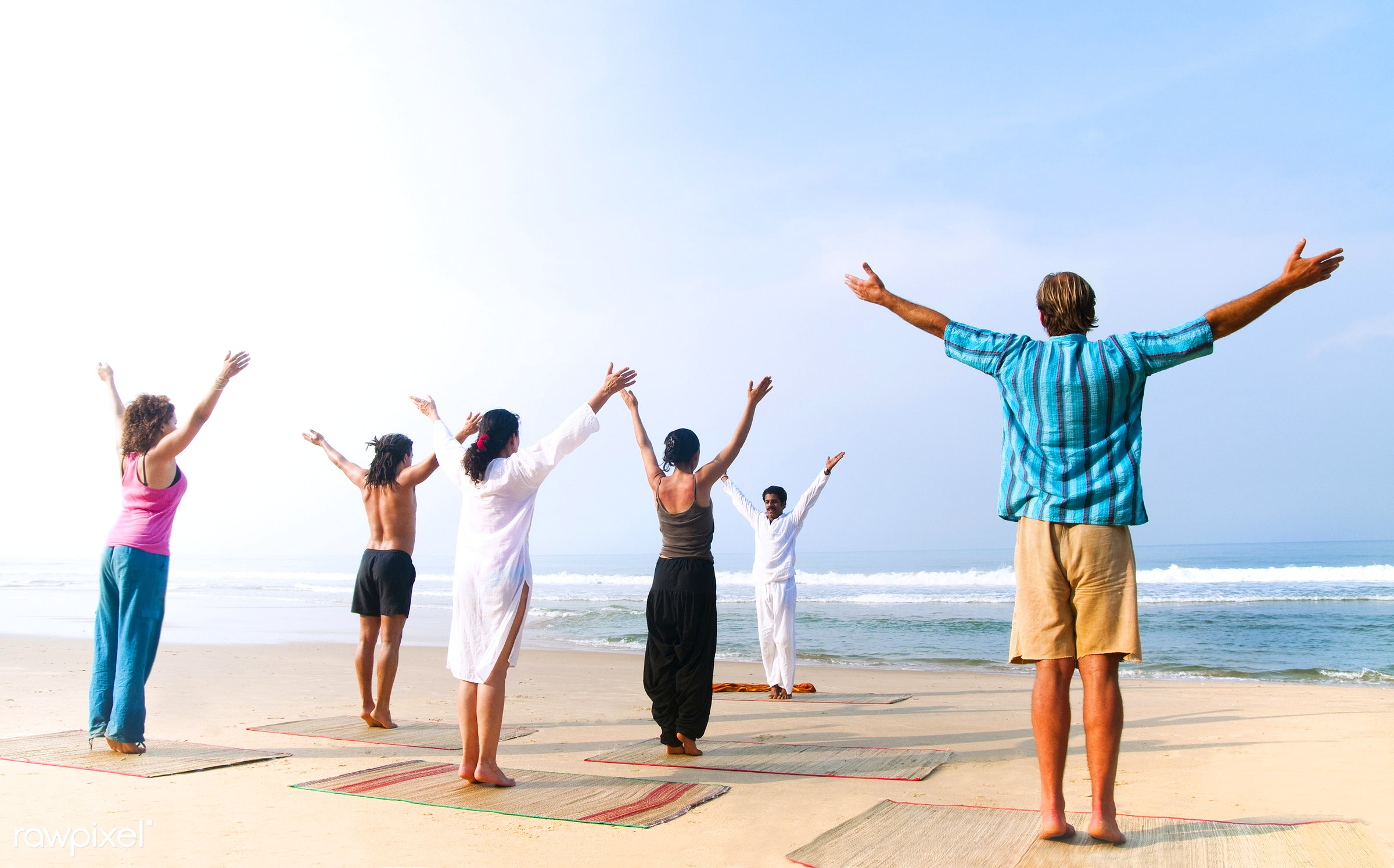 Yoga class on the beach - yoga, indian, beauty in nature, activity, adult, arms raised, beach, body, body care, casual,...