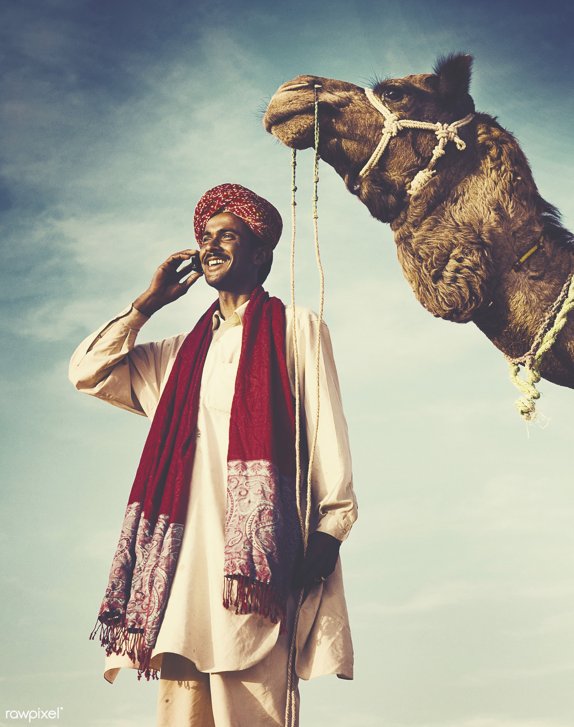 Indian man on the phone with camel - animal, asia, beauty in nature, business, businessman, calling, camel, cellphone,...