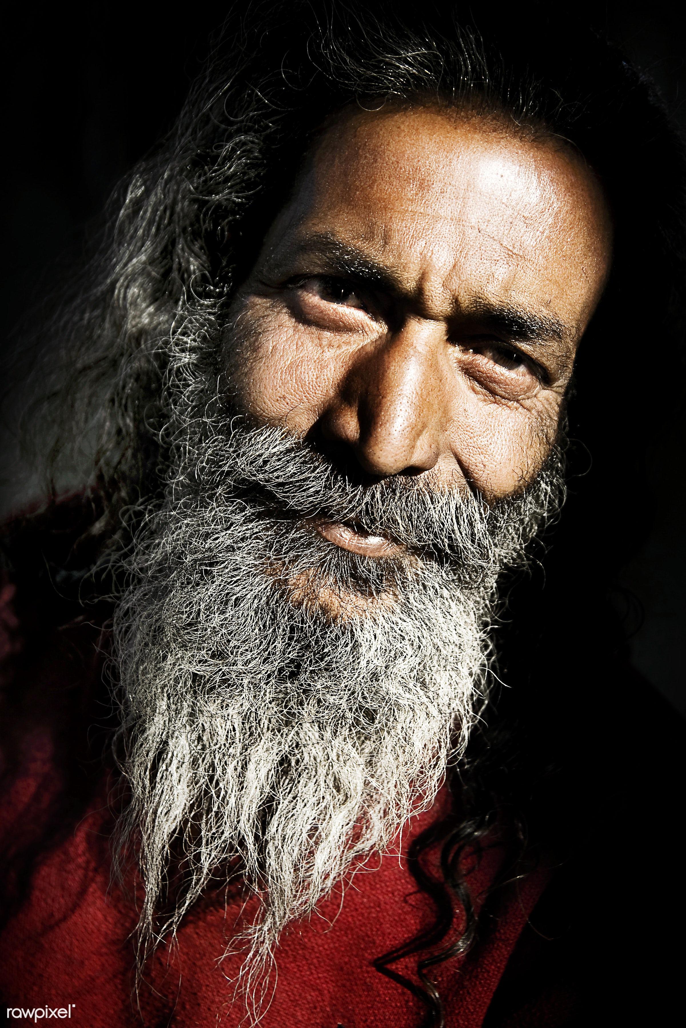 Senior Indian man looking at the camera. - carrying on the head, close-up, concepts, despair, facial hair, farmer, grumpy,...