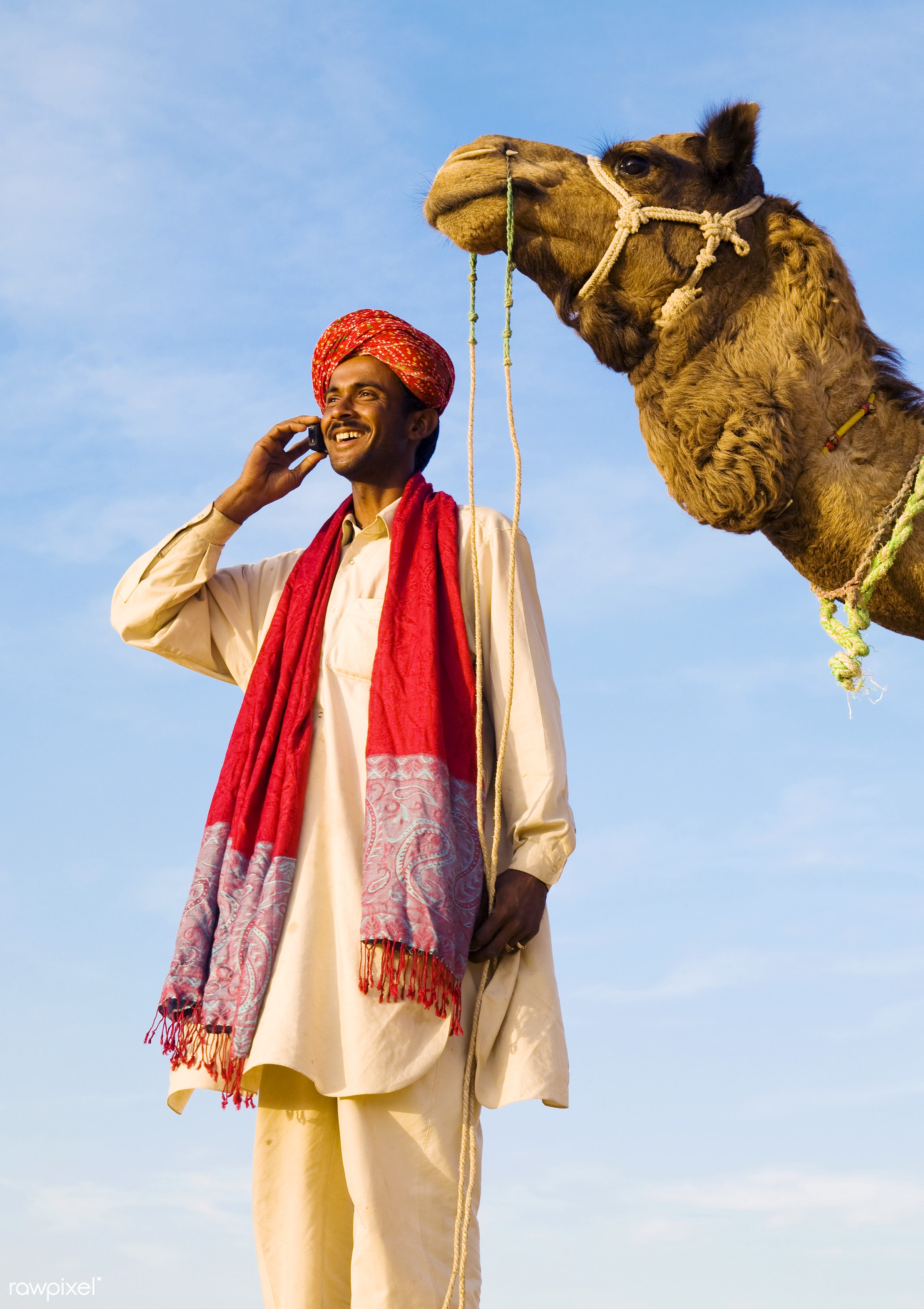 Indian man with camel making a call - asian, animal themes, asia, beauty in nature, business, businessman, camel, cellphone...
