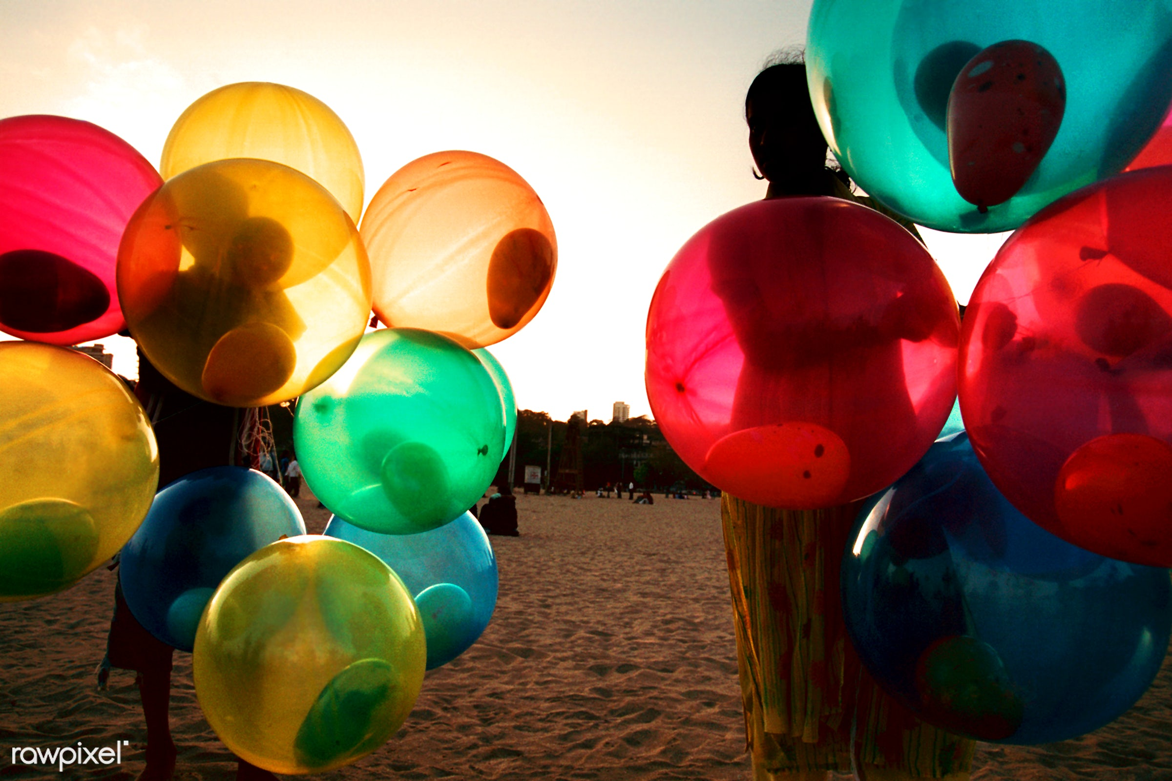 Girl on beach with colorful balloons - balloon, beach, bouquet, bright, brightly lit, child, color image, colorful, colors,...