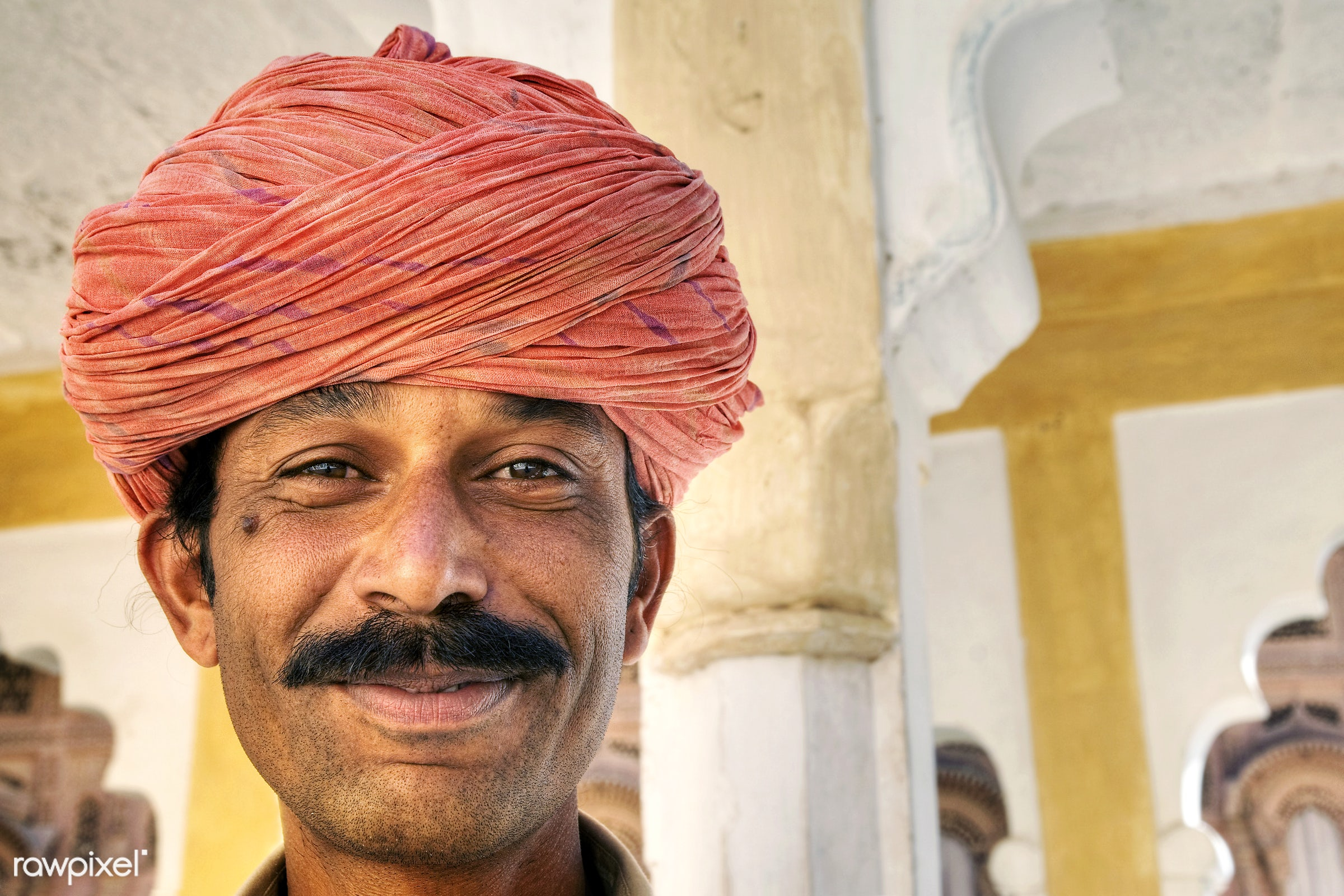 Indian man smiling to the camera. - lifestyles, adult, architecture, asia, asian ethnicity, built structure, cheerful,...