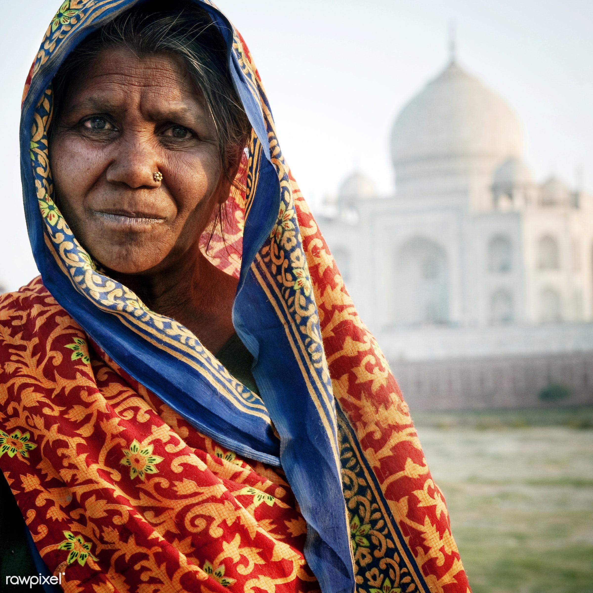 Indian woman in front of the Taj Mahal - 7 wonders, architectural styles, architecture, architecture and buildings, asia,...
