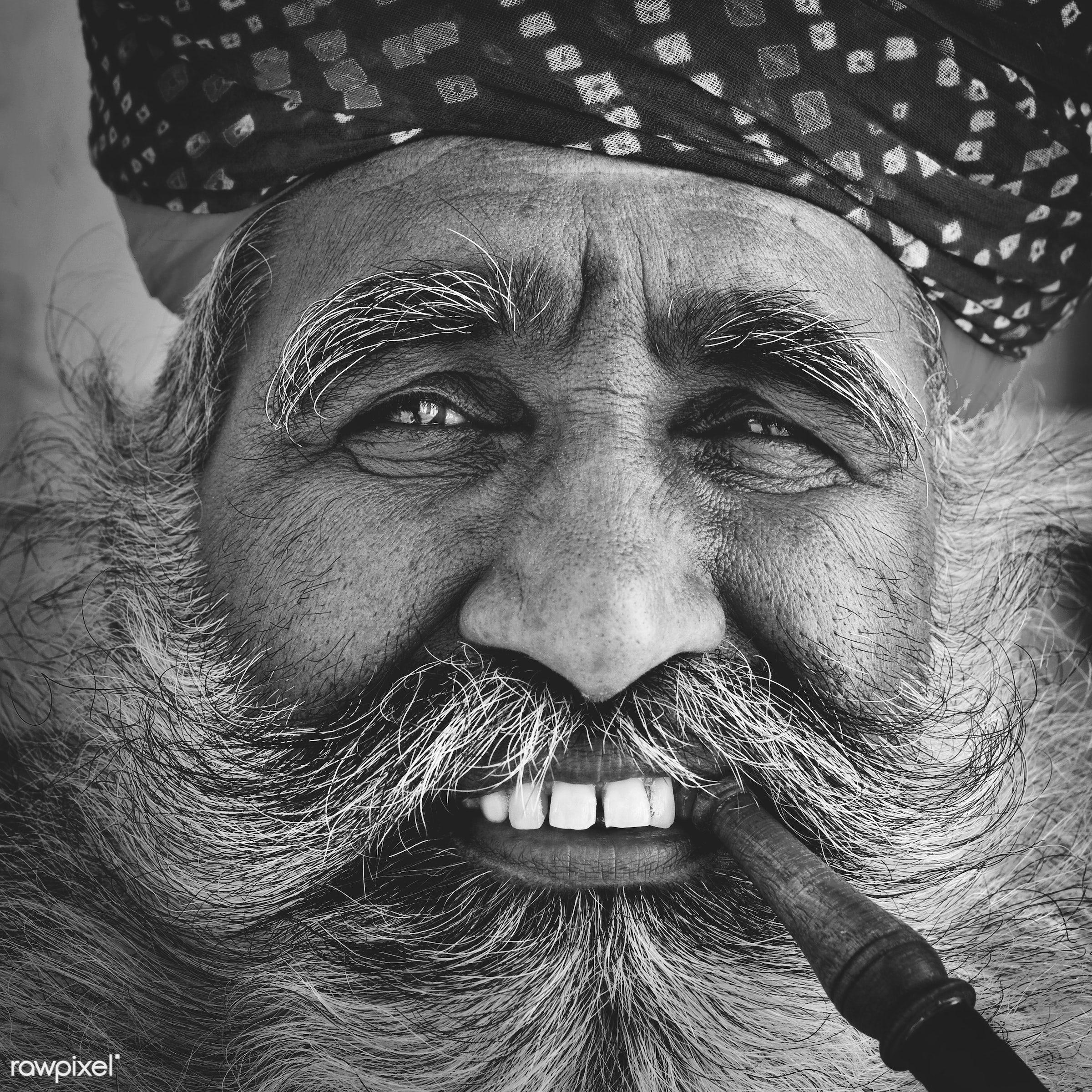 Bearded Indian man smoking a pipe - adult, asia, beard, brahmin, characters, face, fine art portrait, human face, india,...