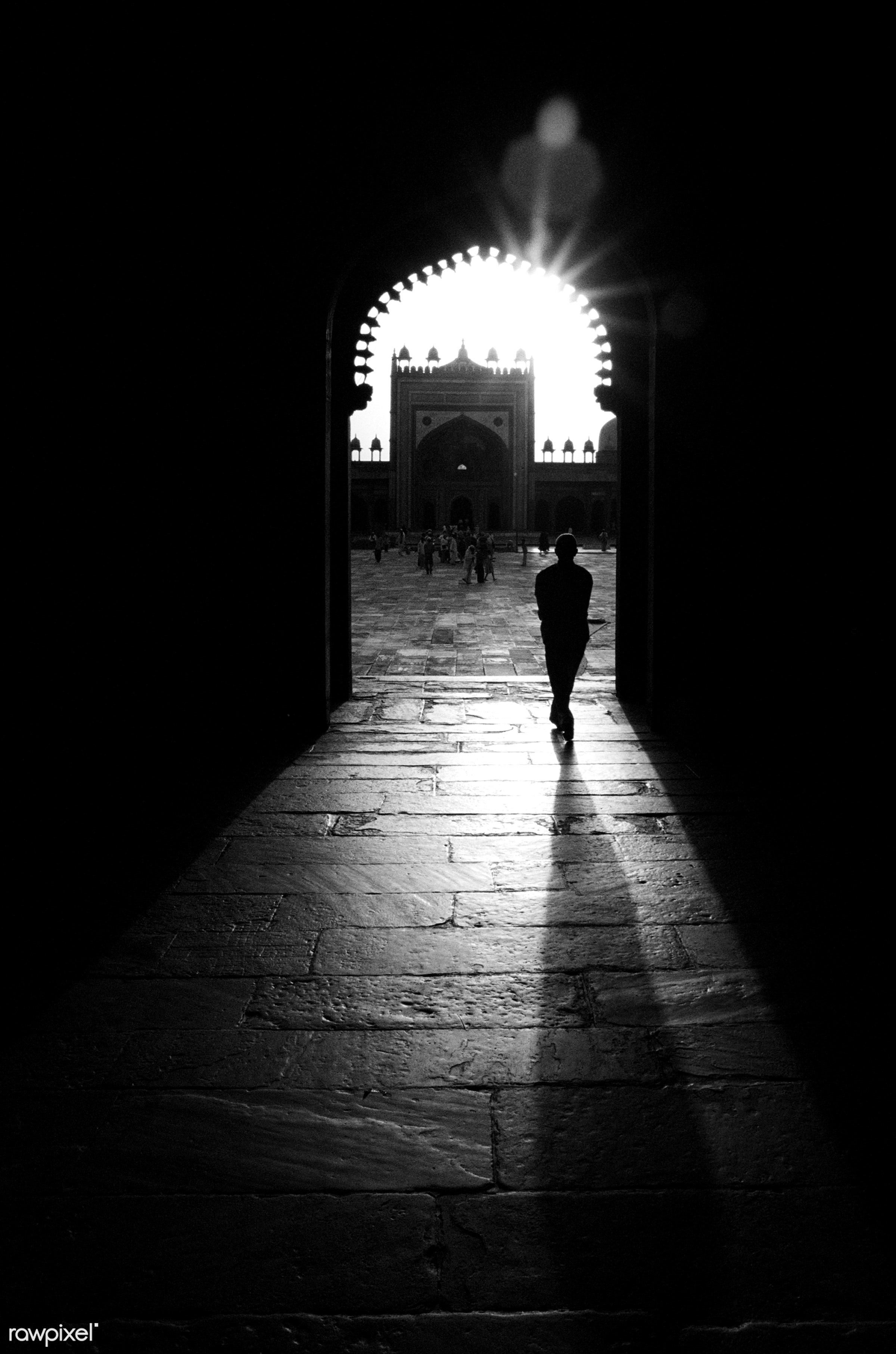 Silhouette of man walking through a mosque - islam, alam, arch, asia, asian culture, asian ethnicity, back lit, black, dusk...