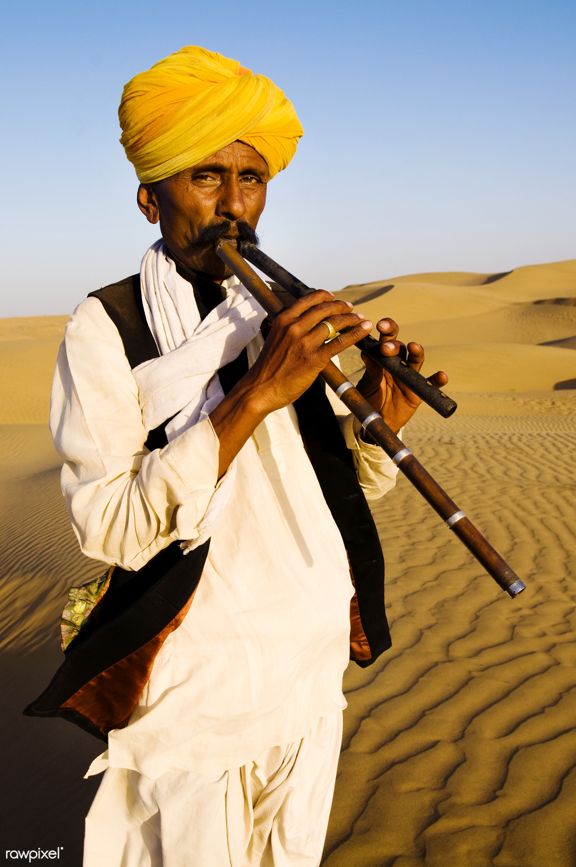 Indigenous Indian man playing wind pipe in a desert. - asia, culture, day, desert, exoticism, heat, india, indian, indian...