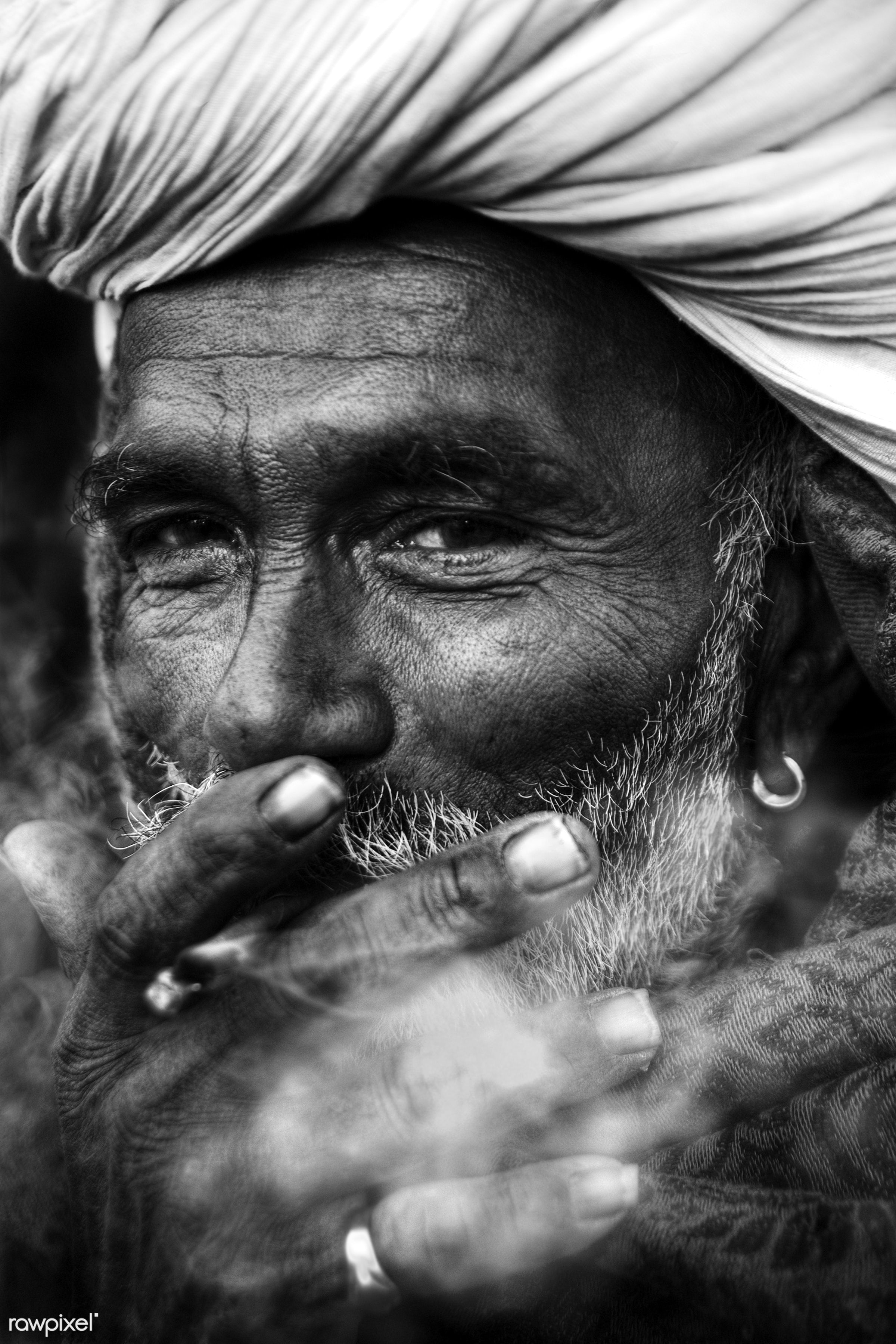 Portrait of an Indian man smoking - adult, asia, beard, brahmin, casual, characters, fine art portrait, golden ring, human...