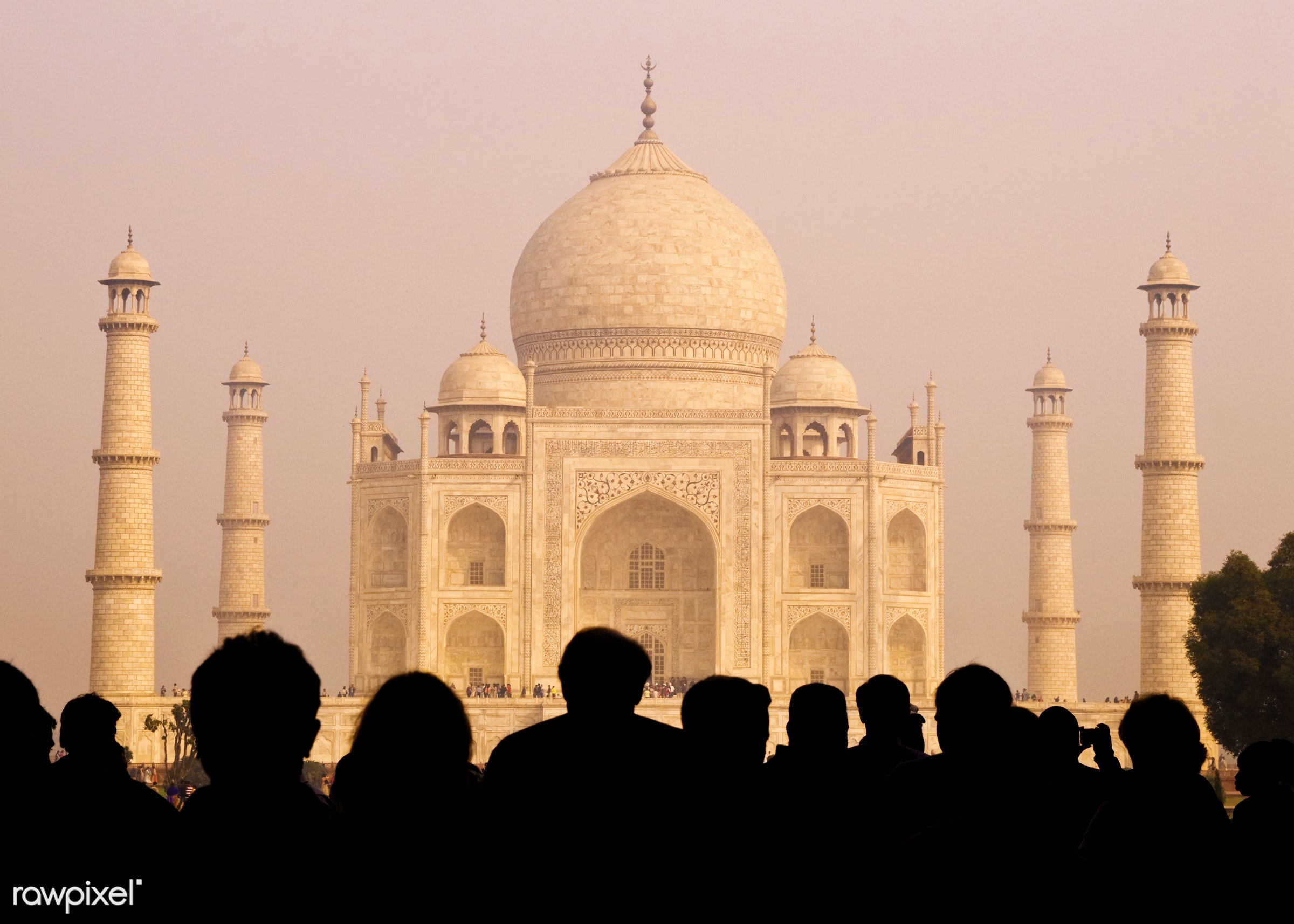 View of the Taj Mahal with tourist silhouettes - 7 wonders, international landmark, lifestyles, architectural styles,...