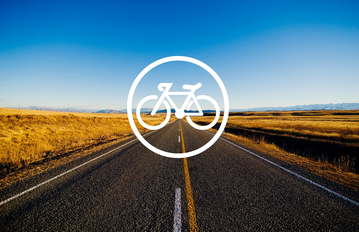 Bike banner shape in circle with rural street scenic and mountain range landscape view