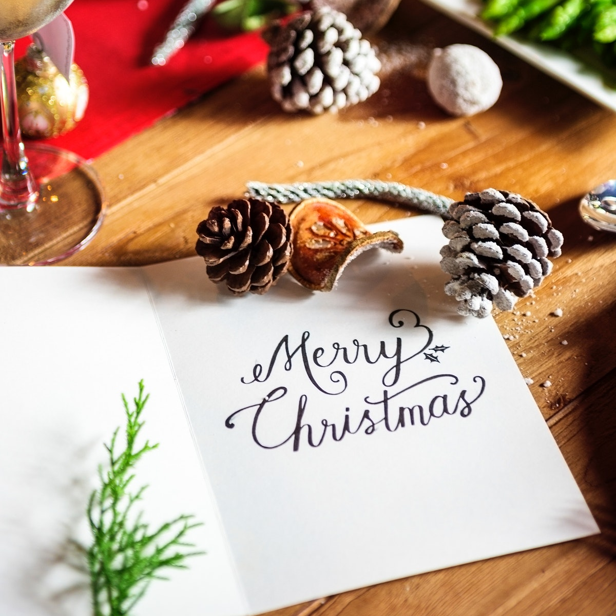 Merry christmas word card on wooden table holiday celebration