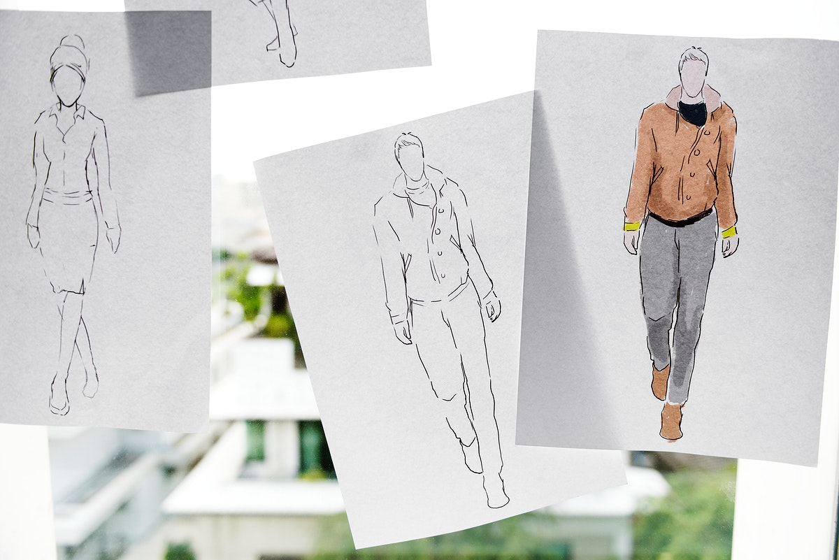 Closeup of fashion sketch design papers on window glass