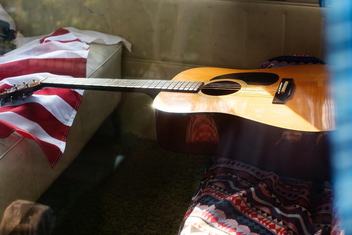 Guitar and American Flag on Van Rear Seat Road Trip Travel Journey