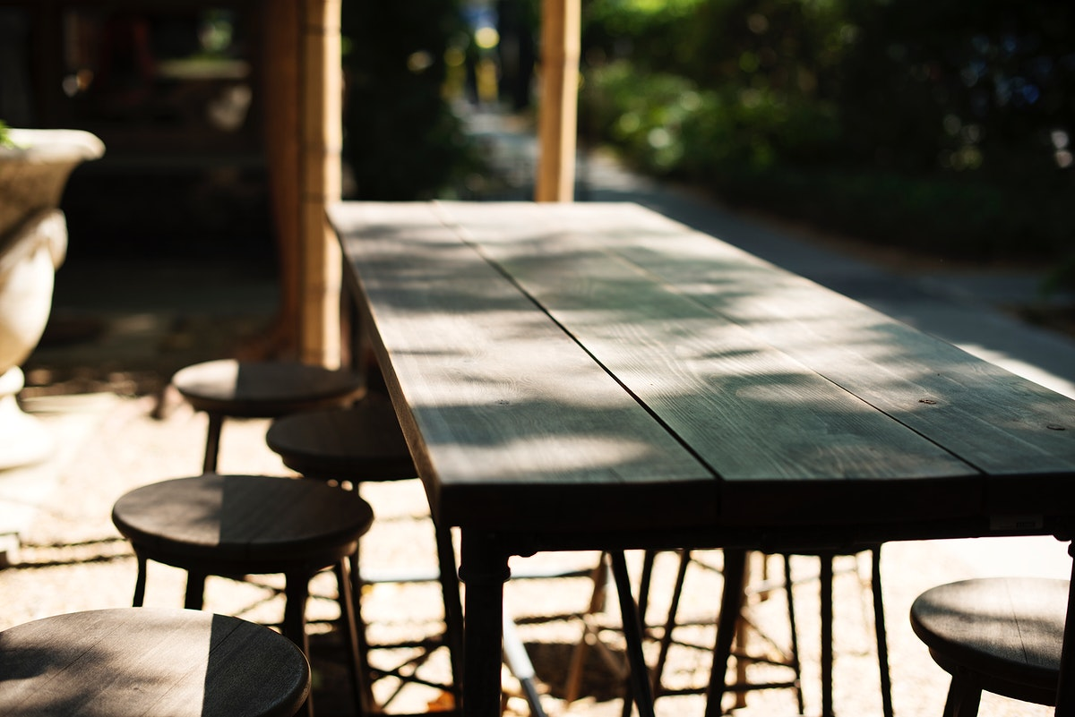 Wooden table of the outdoors cafe
