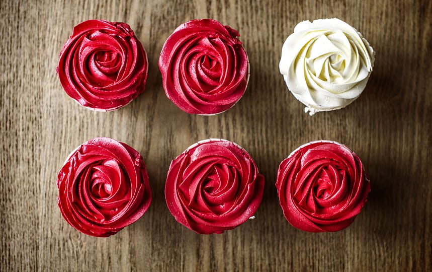 Beautiful Rose Cup Cakes on Wooden Background