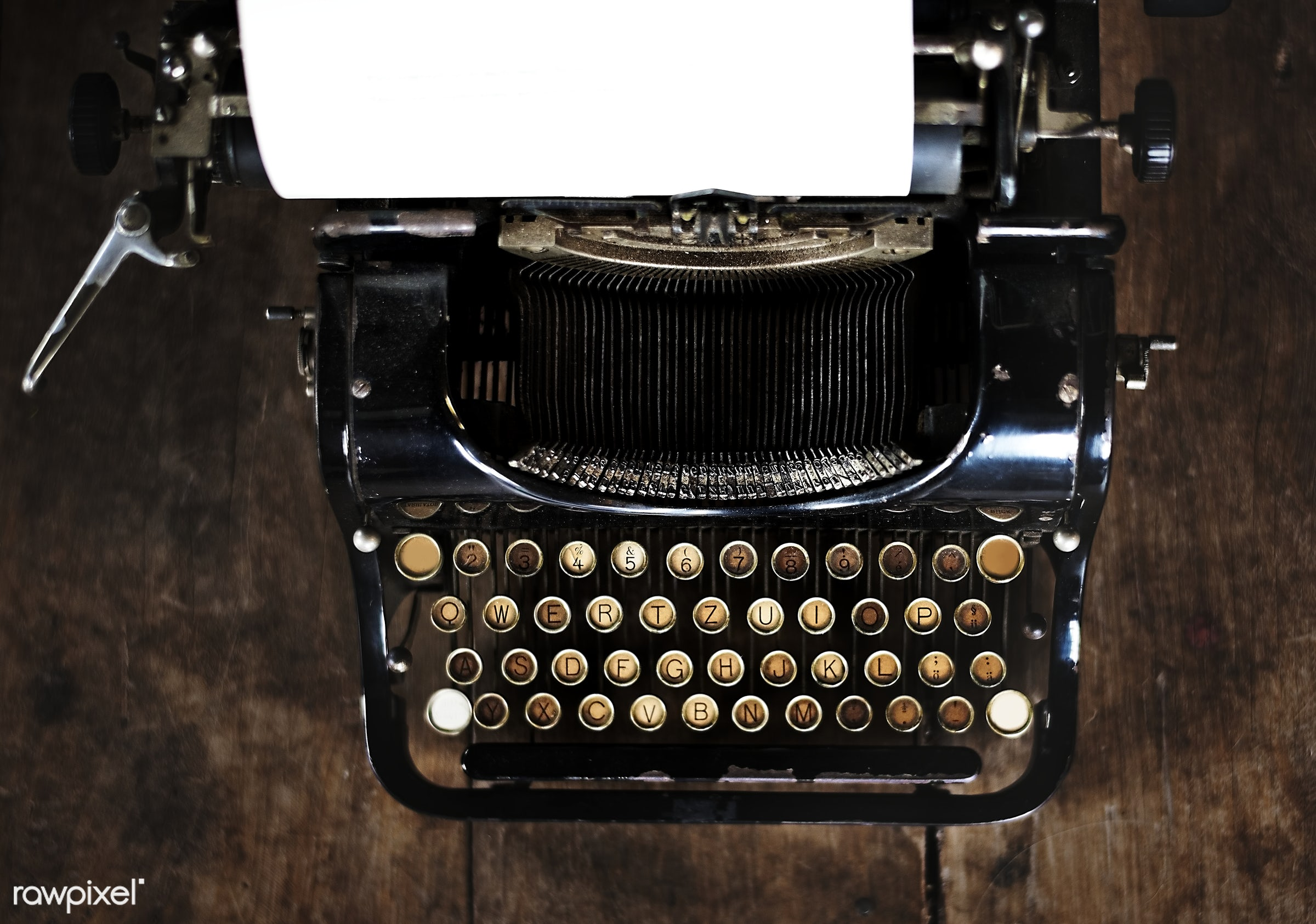Vintage style typewriter on a wood desktop  - antique, attach, attached, classic, closeup, equipment, journalism, keyboard,...