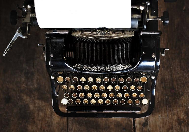 Vintage style typewriter on a wood desktop