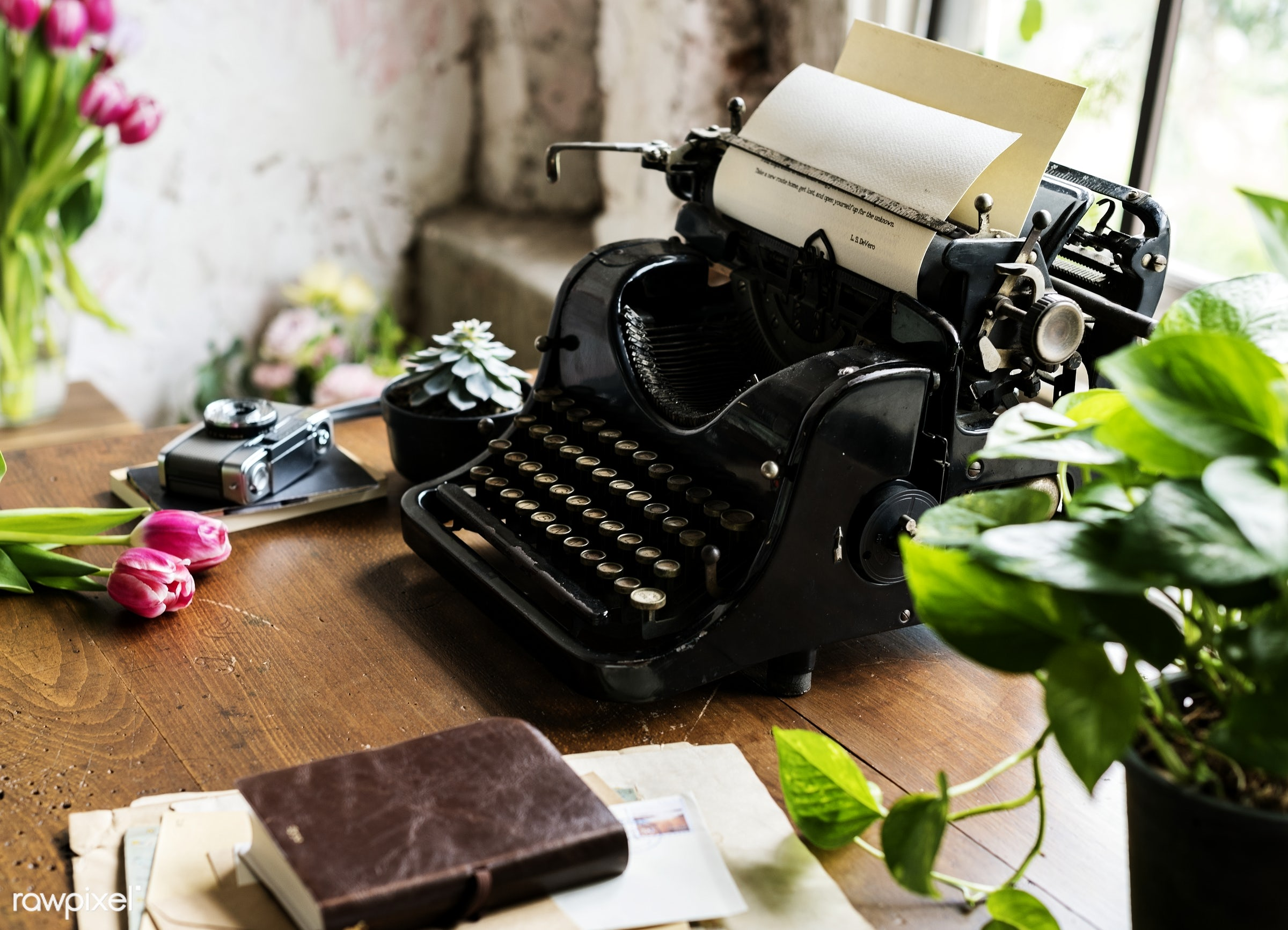 Vintage typewriter on a desk by a window - desk, typewriter, antique, attach, attached, book, classic, closeup, equipment,...
