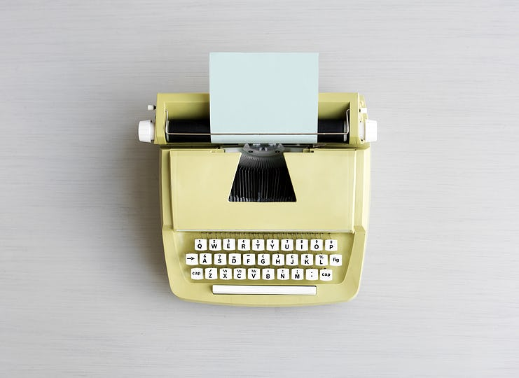 Retro Typewriter Machine on Gray Table