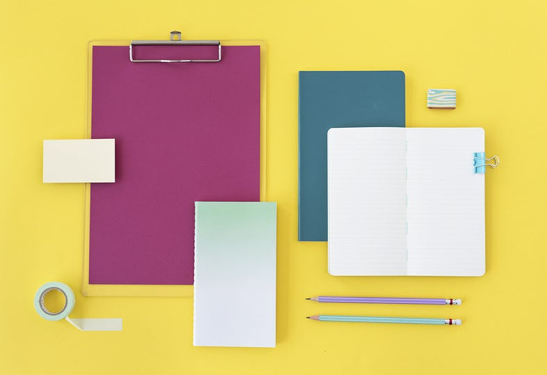 Office supplies on yellow surface