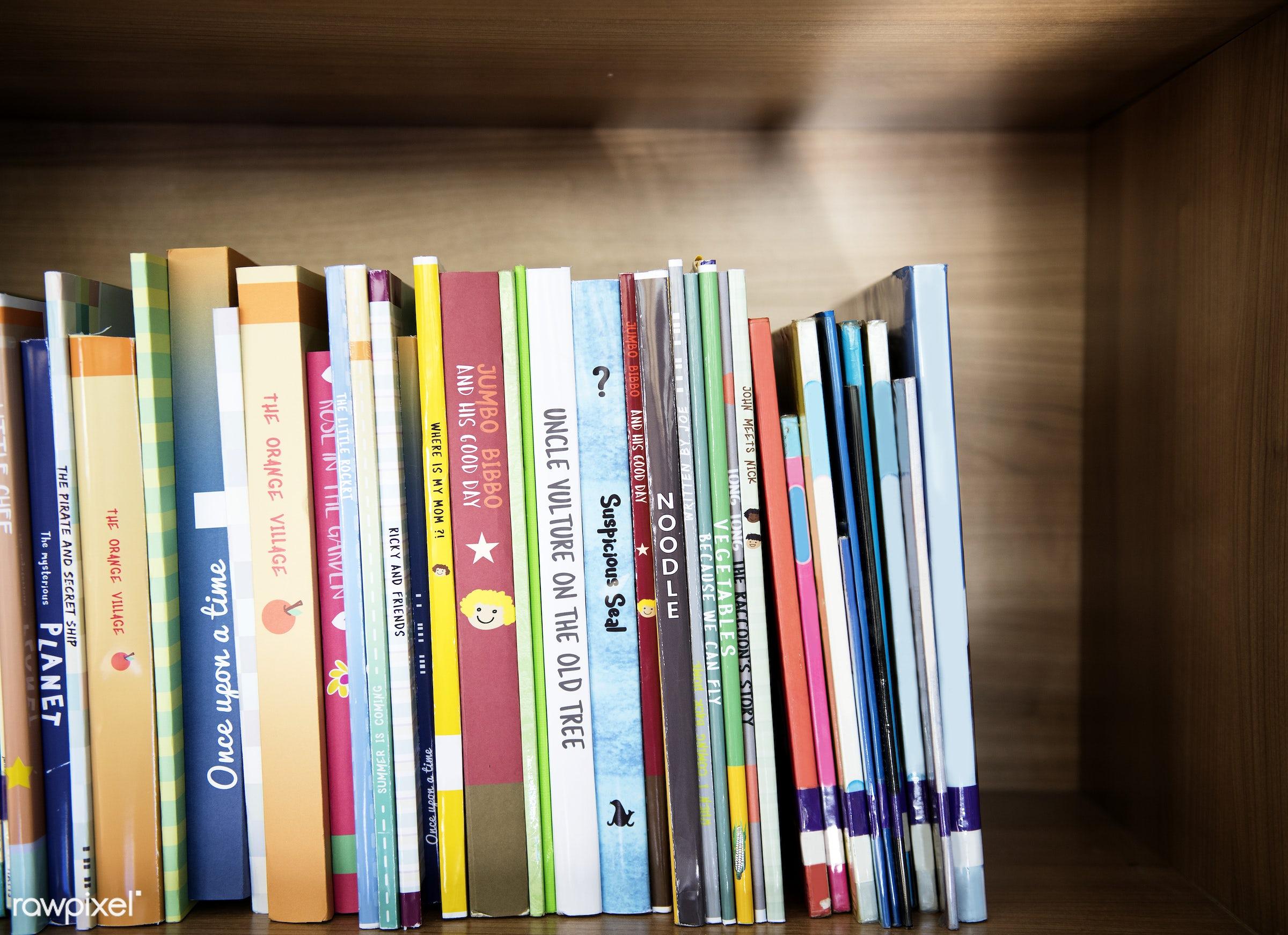 Children's books at elementary school library - education, stack, story, books, bookshelf, children, covers, drawing,...