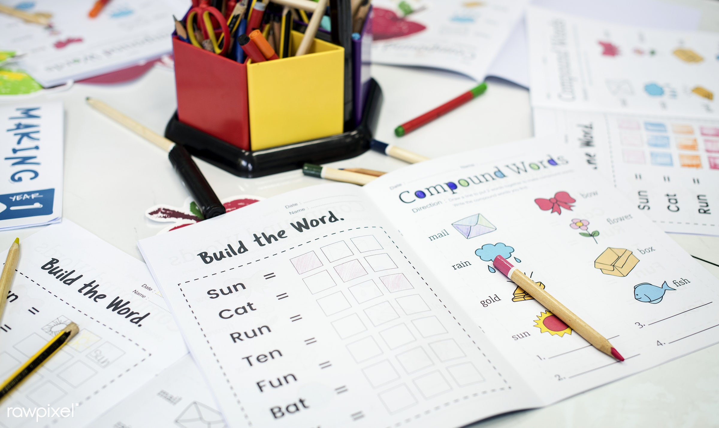 Elementary school classroom - nobody, arts, children, colored pencils, together, words, workbook, hands, painting, students...