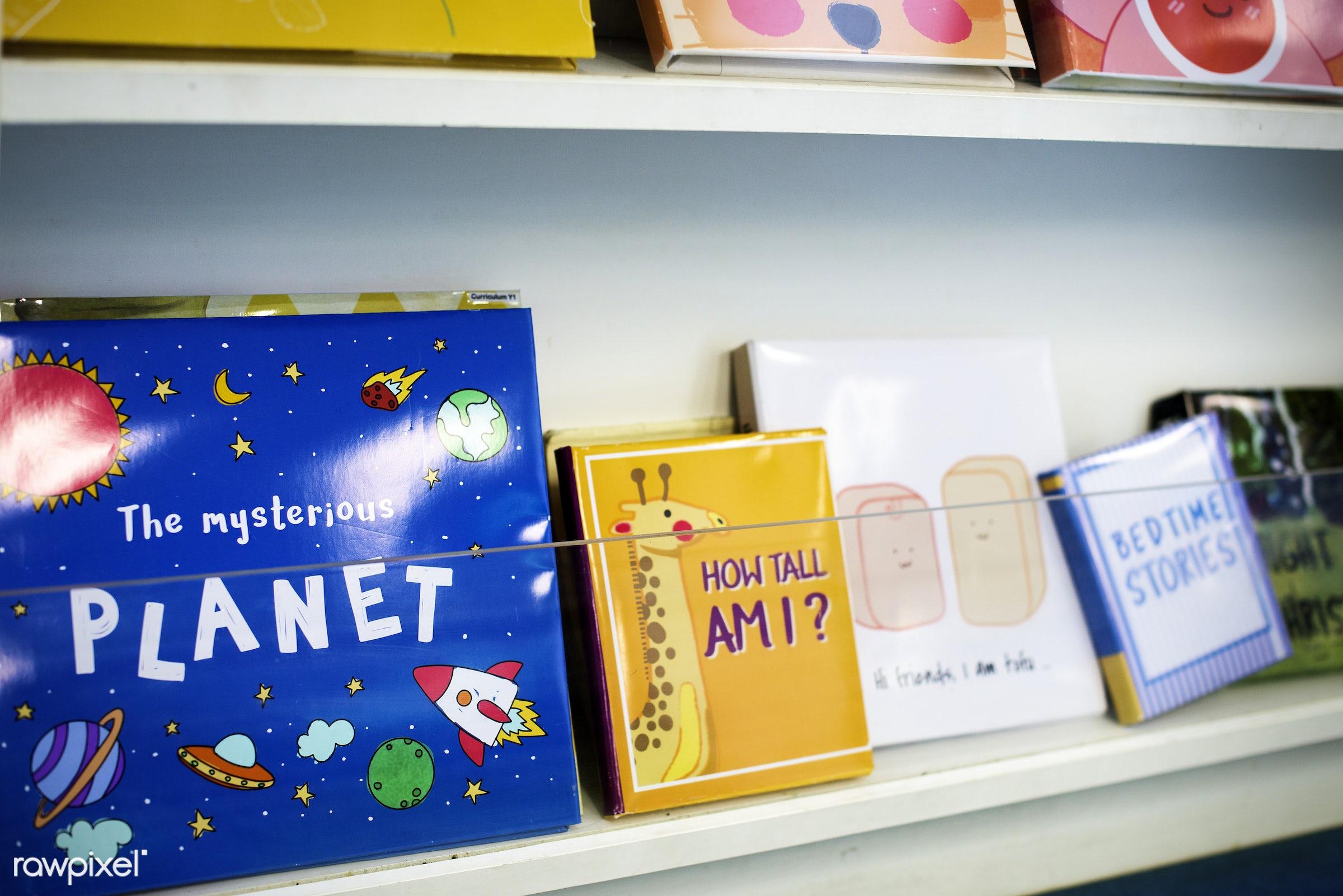Children's books at elementary school library - nobody, children, entertain, drawing, story, time, pile, shelf, books,...