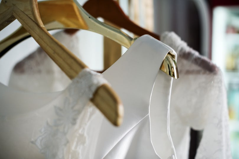 White Wedding Dress Hanging by the Window