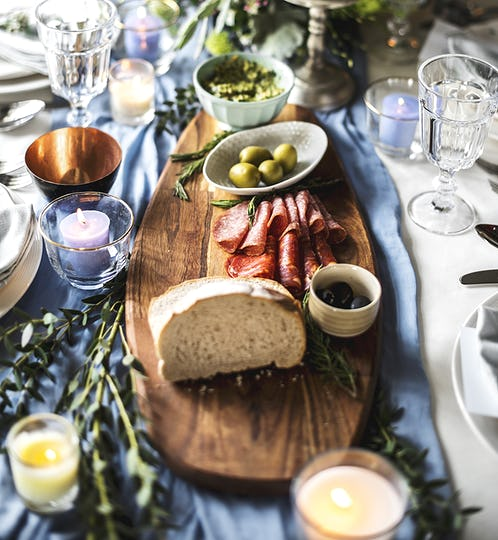 Closeup of Wedding Reception Table Setting with Food