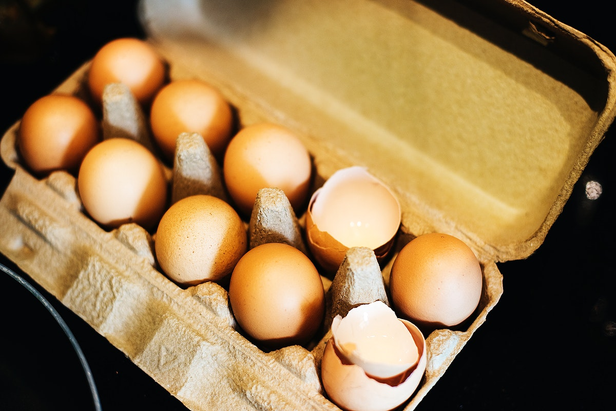 Tray of dozen eggs with shells