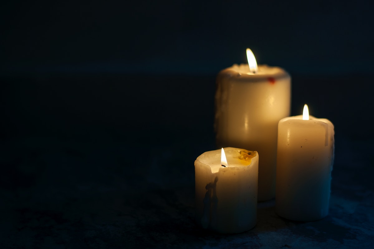 Closeup of lighted candles in the dark