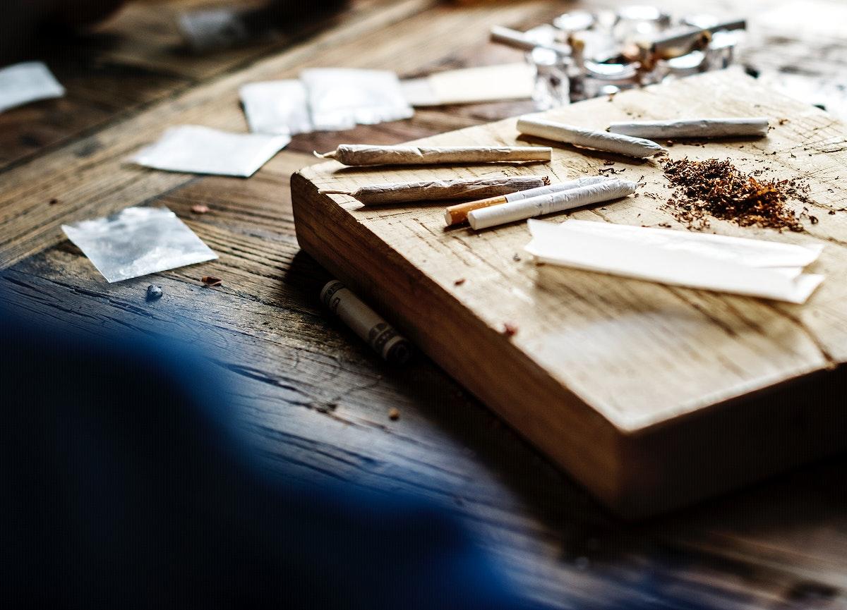 Cigarette roll paraphernalia on the table