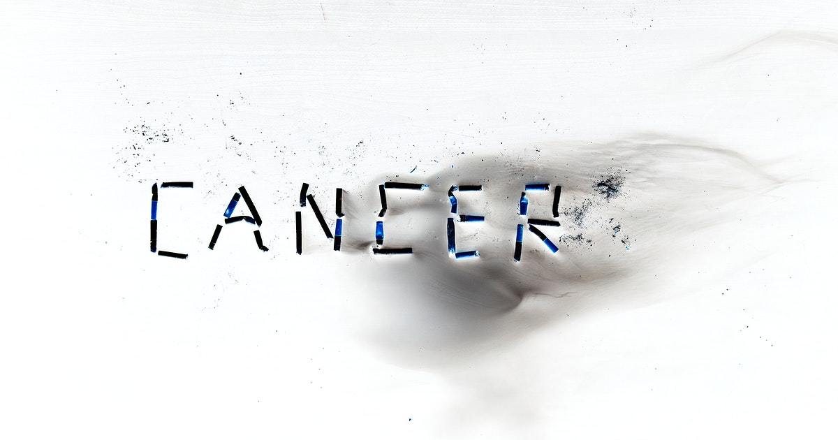 Negative image of cigarettes forming the word cancer