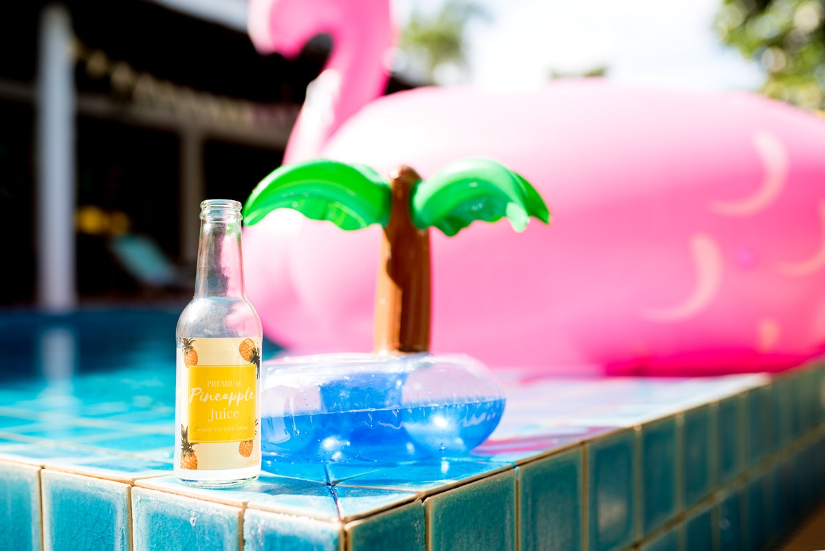 Closeup of pineapple juice bottle with inflatable