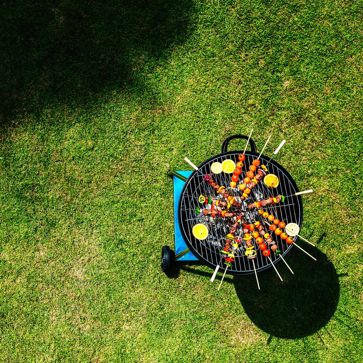 Aerial view of barbecues steaks on the charcoal grill