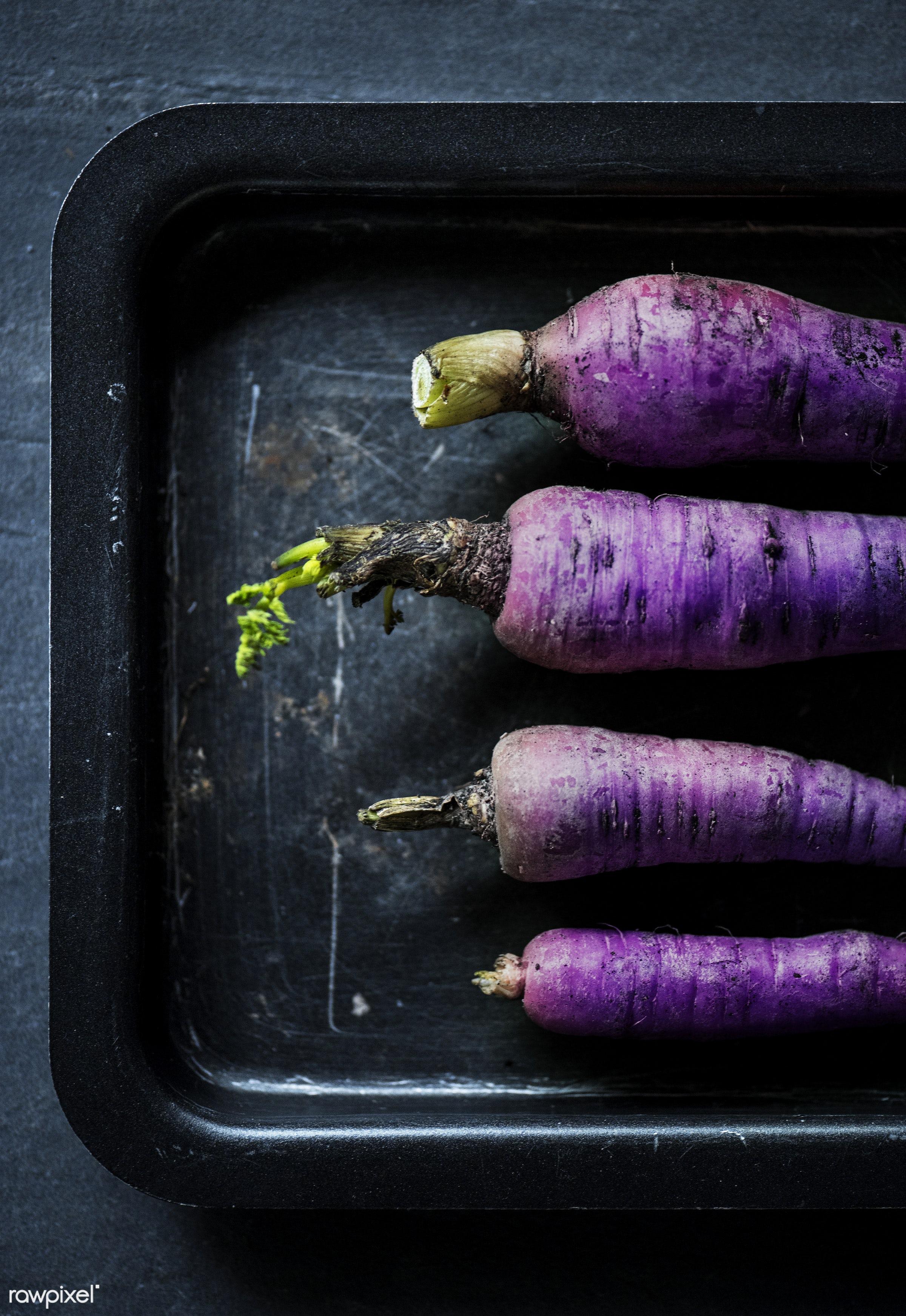 Purple Carrots - raw, nobody, black background, farm, ingredients, daikon radish, nature, black plate, fresh, aerial view,...