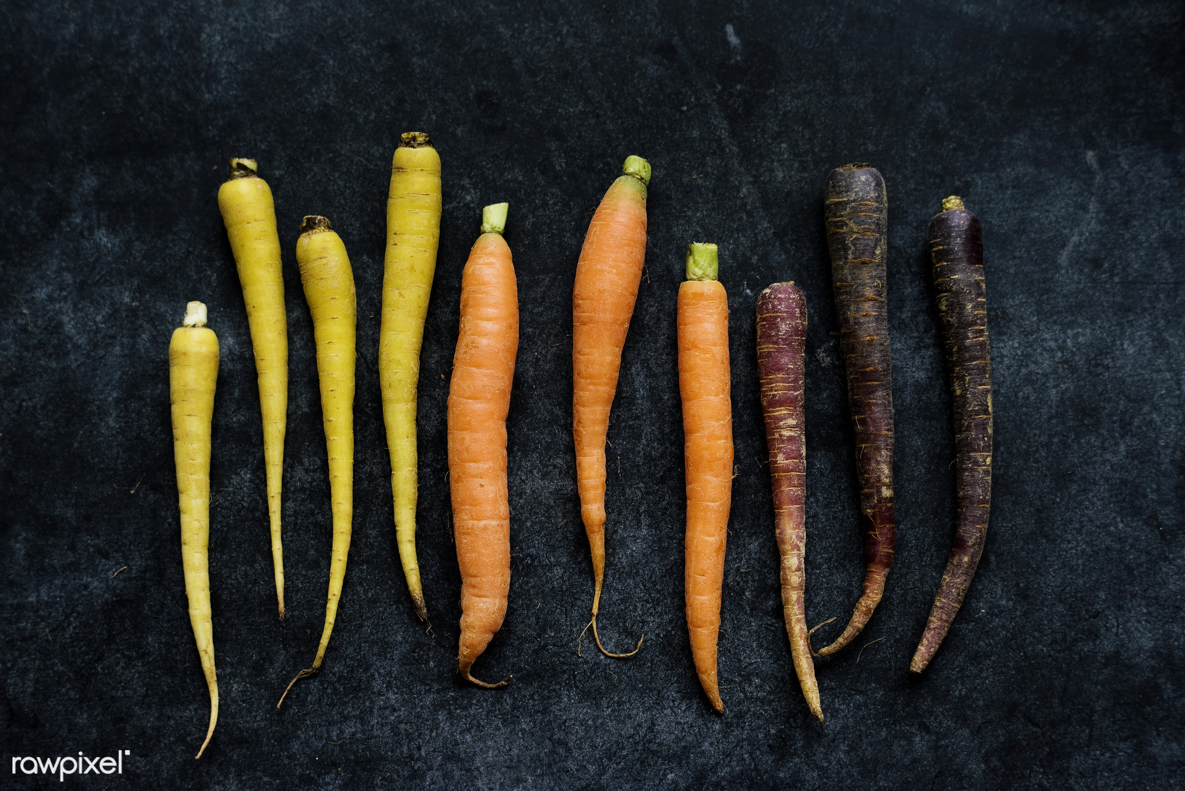 Fresh organic carrots - aerial, nutrients, black background, real, organic, fresh, mixed, carrots, various, bunch, types,...