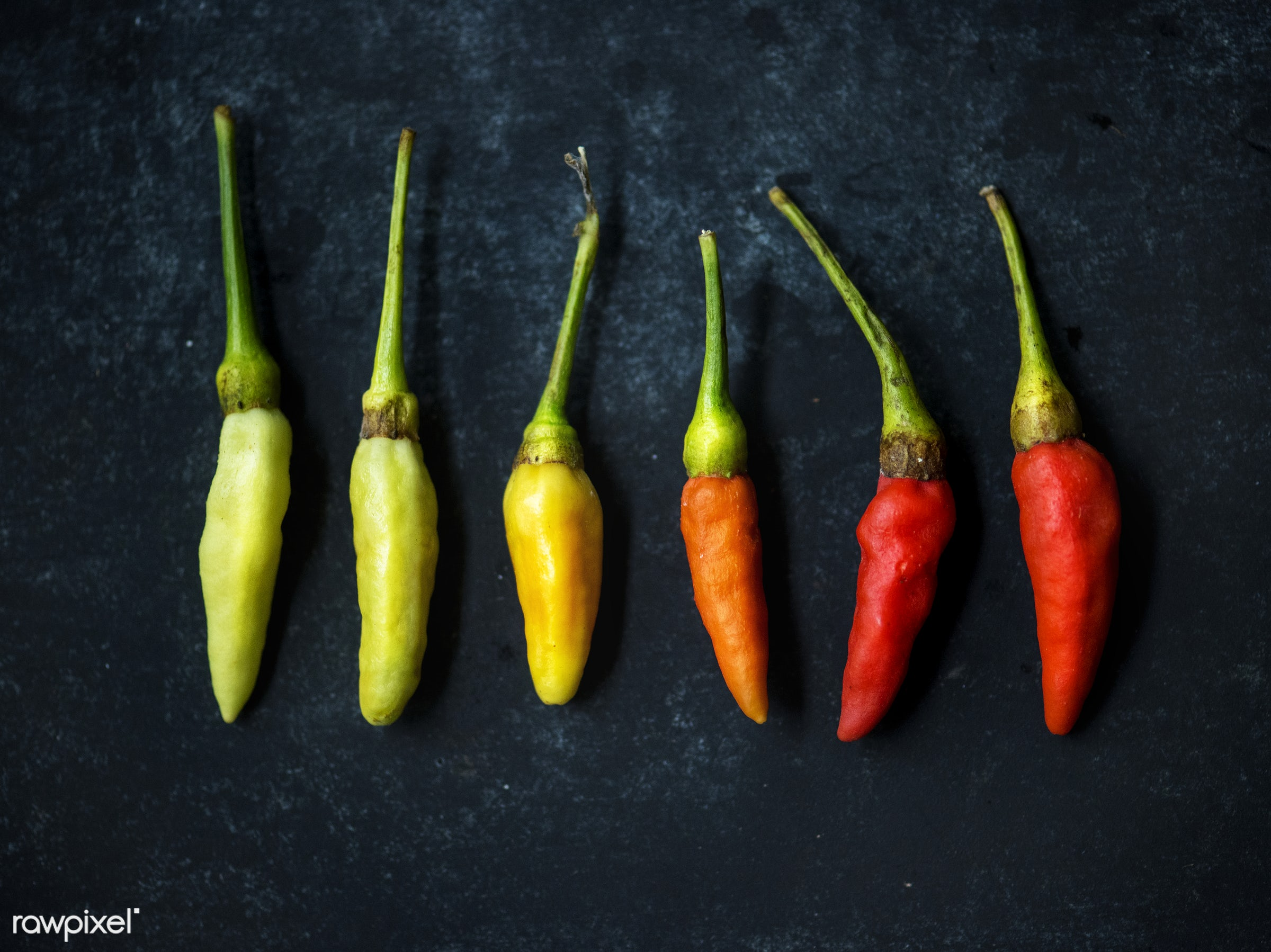 Fresh chili peppers - nobody, herbs, colors, spices, chili, asian, black background, ingredients, real, organic, asian...