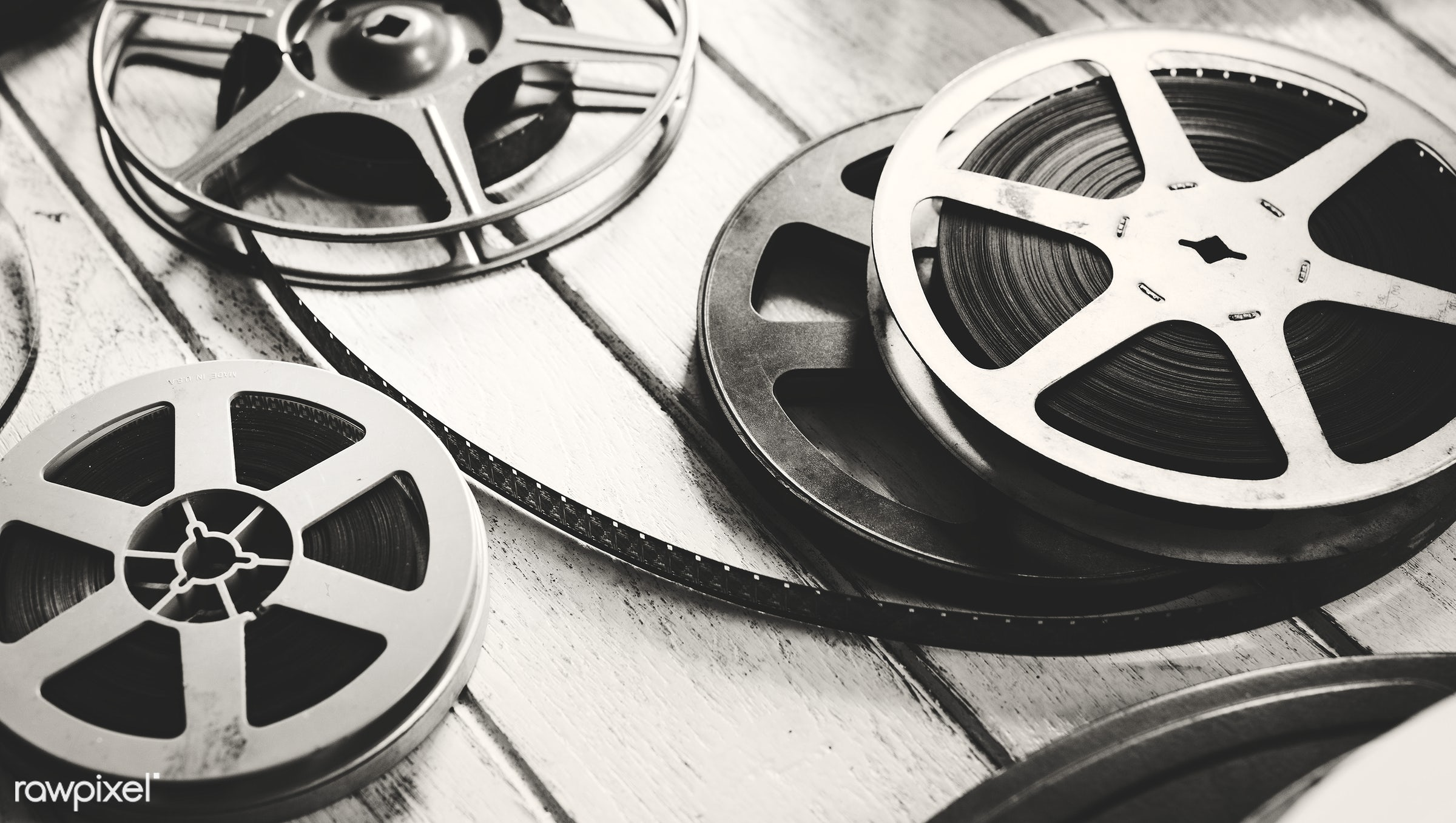 Vintage film strip isolated on wooden floor - film, cinema, action, analog, antique, entertainment, equipment, film strip,...