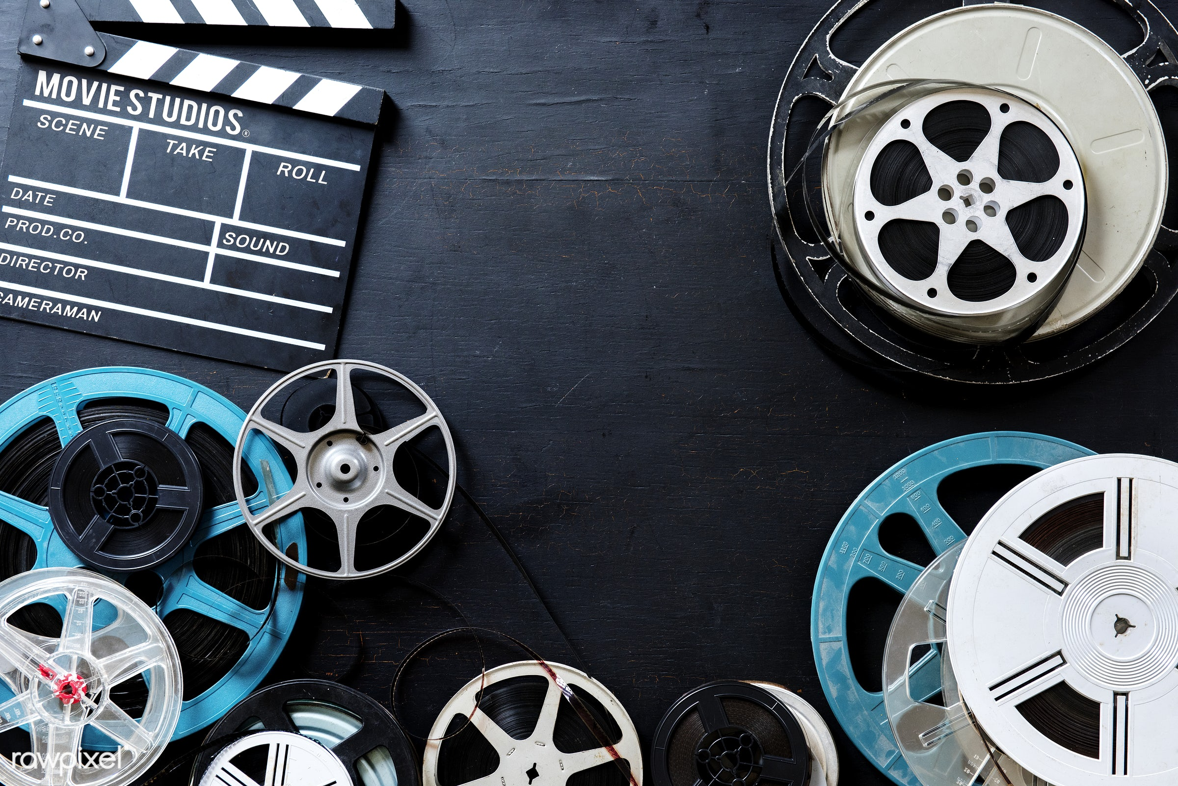 Retro video film rolls - cinema, film, video, movie, action, analog, antique, entertainment, equipment, film strip, industry...