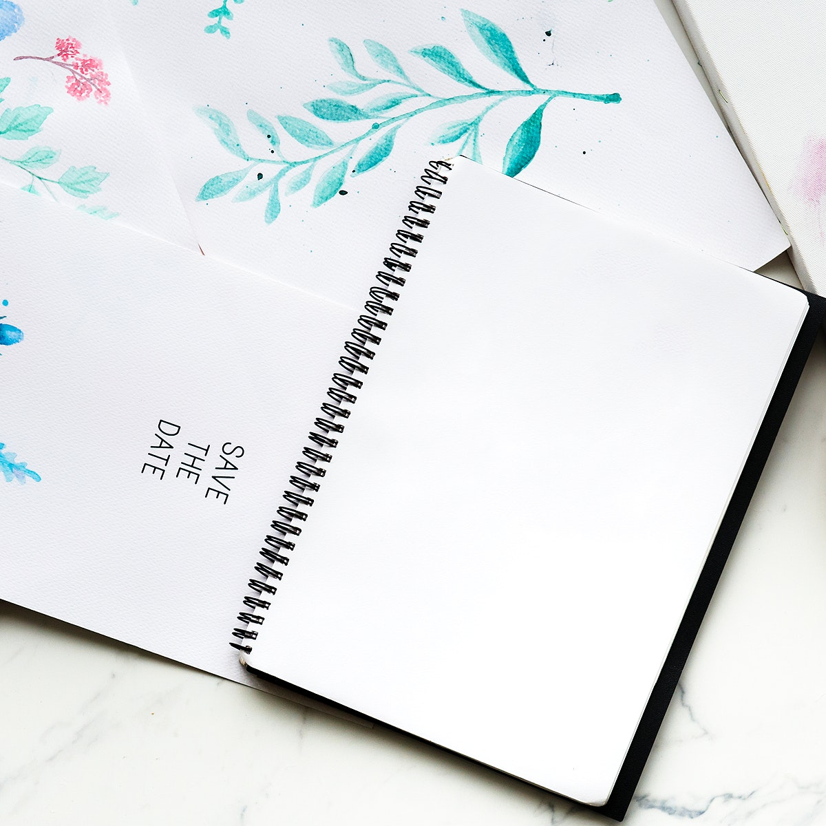 Blank copy-space notepad and drawing of foliage