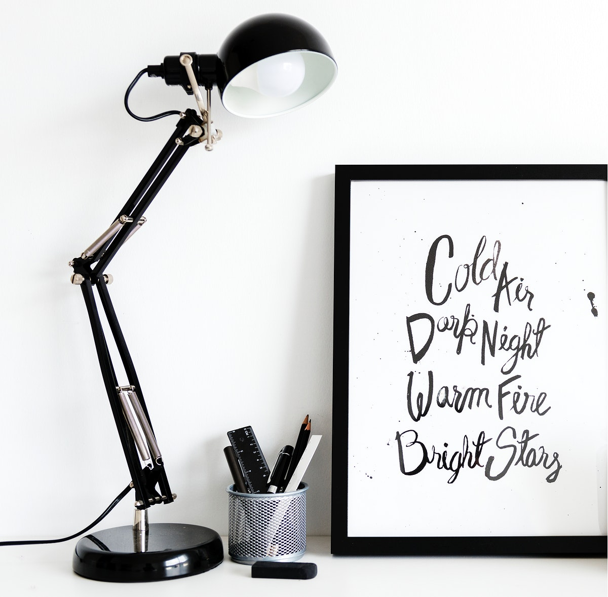 Black lamp with stationery box by the phrase frame isolated on white