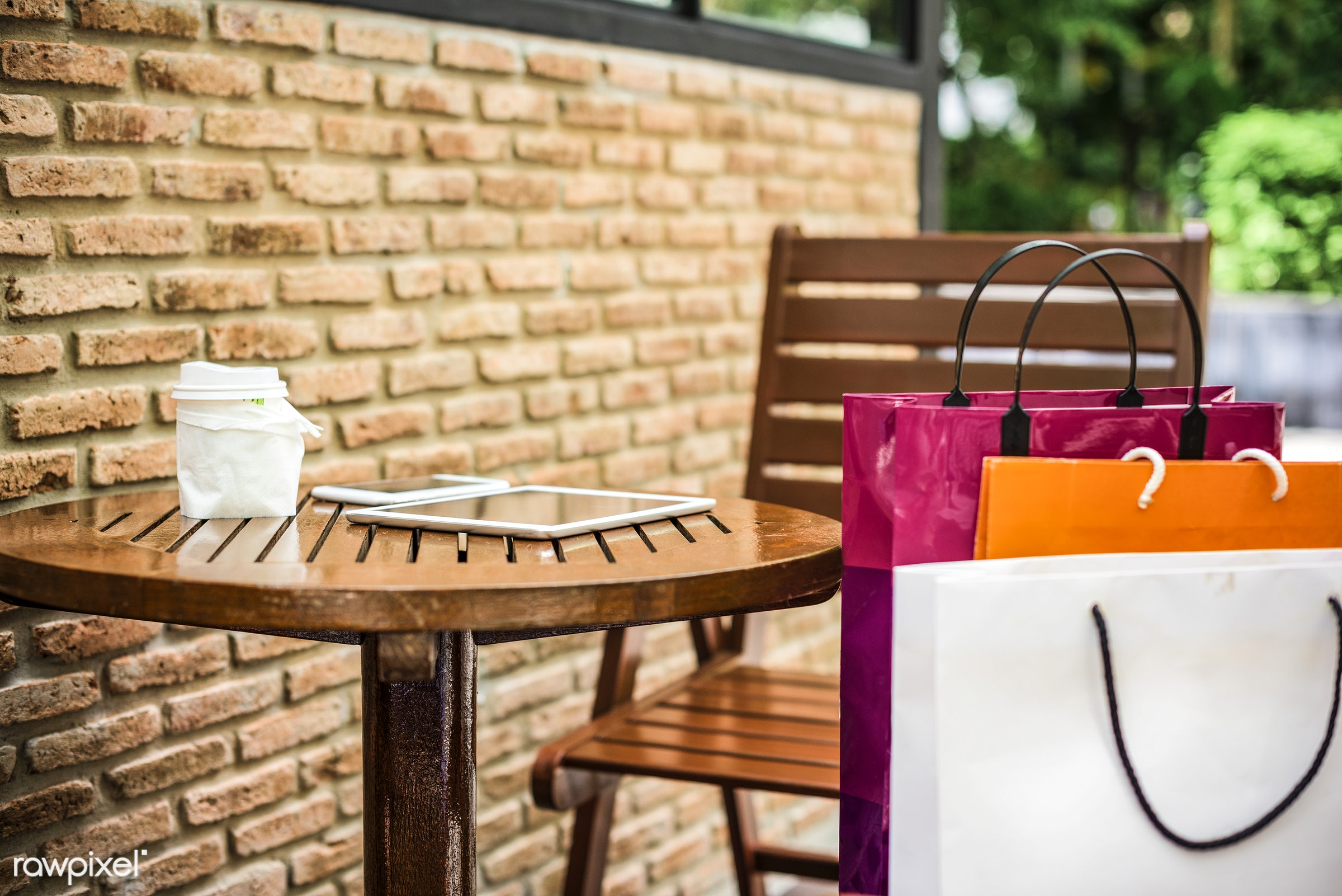 Shopping bags on an outdoor cafe - sale, shopping, commerce, shop, shopper, technology, store, spend, coffee shop, purchase...