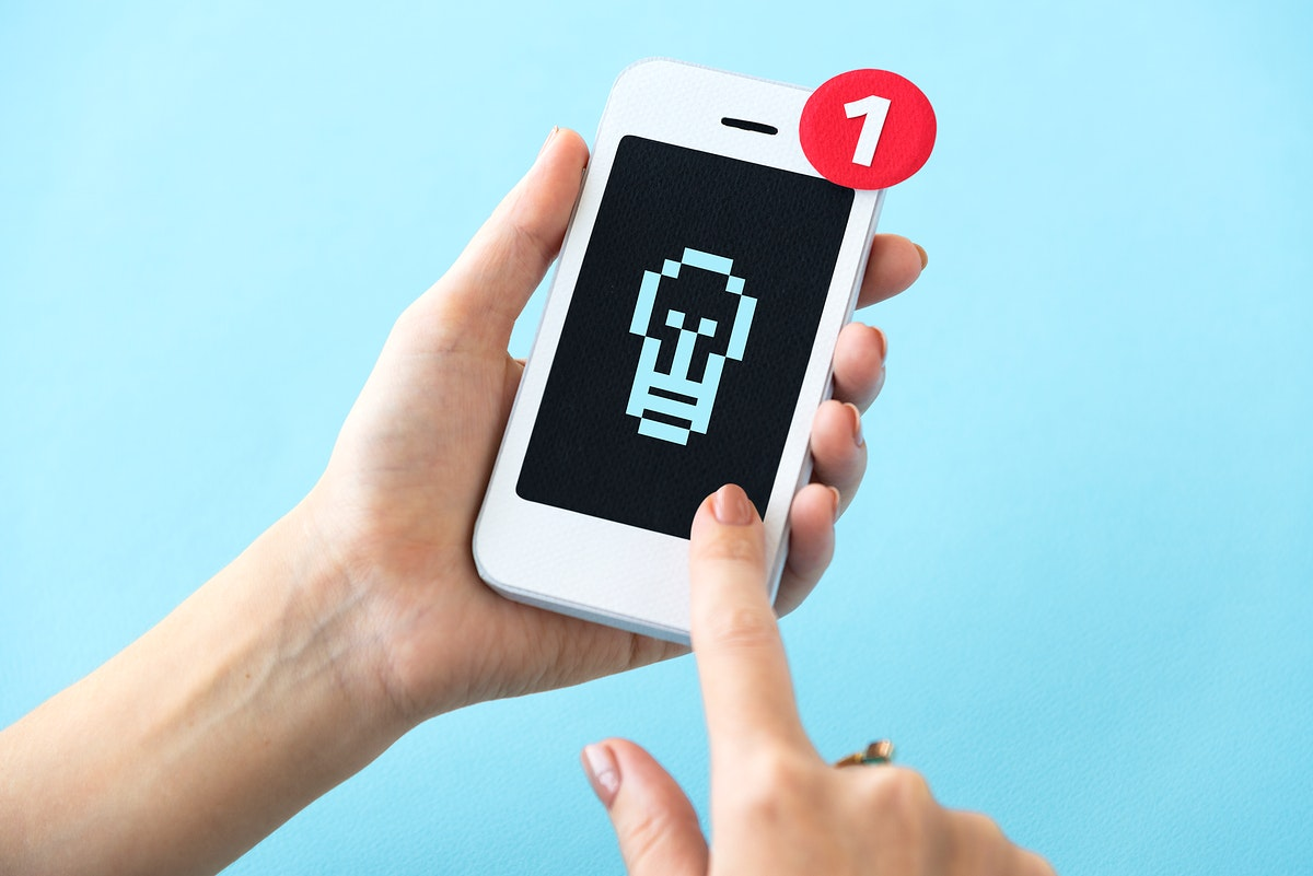 Closeup of hands holding paper craft mobile phone mockup
